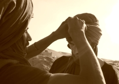 My very own turban being fitted by Tuareg, Erg Chigaga, Morocco.