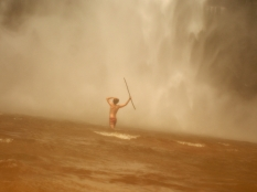 in the might of the Wli waterfalls, Ghana, during monsoon season.