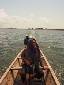 Crossing Lake Volta in a wooden boat.