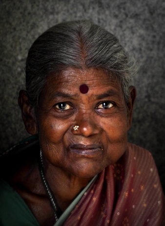 She was the lady who sold flowers at the temple, Bangalore, India.
