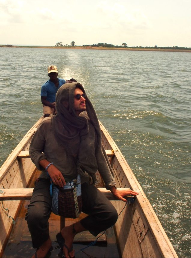 Crossing lake Volta in a wooden boat, which naturally had a hole in it...